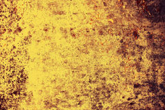 Backdrop of old yellow grunge wall Royalty Free Stock Photos