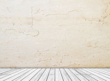 Backdrop sandstone wall and wood slabs arranged in perspective texture background. Stock Photo