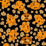 Seamless pattern with pumpkin lights on black background Royalty Free Stock Photo