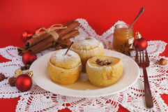 Backed apples with sugar frosting on red backgroun Stock Photos