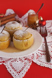 Backed apples with sugar frosting on red backgroun Stock Images