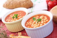 Backed beans. Some fresh backed beans with a sauce of tomatoes stock photo