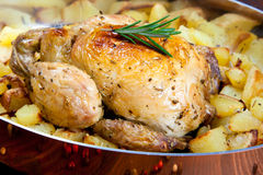 Backed chicken with potatoes Stock Images