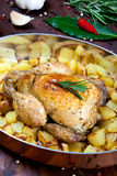 Backed chicken with potatoes Stock Photo