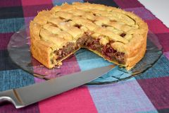 Backed crunchy and sweet homemade cherry pie on a glass plate stock photo