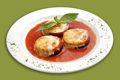 Backed eggplant. Backed eggplant with mozarella cheese and basil Royalty Free Stock Photos
