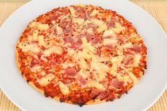 Backed pizza with pinapple and ham. A backed pizza with pinapple and ham Stock Photos