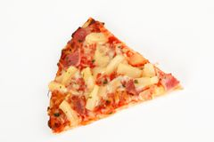 Backed pizza with pinapple and ham. A backed pizza with pinapple and ham Royalty Free Stock Photos