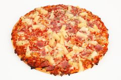 Backed pizza with pinapple and ham. A backed pizza with pinapple and ham Stock Images