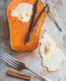 Backed pumpkin half with a scoop of vanilla ice-cream, vanilla s Royalty Free Stock Images