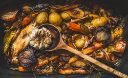 Backed and roasted vegetables , with rabbit meat and cooking spoon stock photos