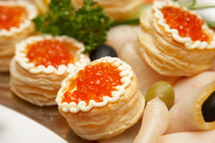 Backed rolls with caviar Stock Photos