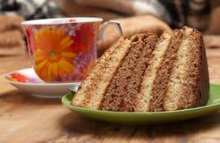 Backen Sie mit Tee oder Kaffee zusammen lizenzfreies stockfoto