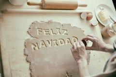 Backenkekse für Weihnachten - feliz navidad lizenzfreies stockfoto