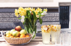 Backet of fruits and bunch of spring flowers Royalty Free Stock Photos