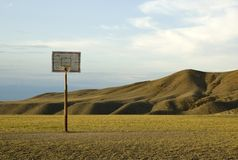 Backetball hoop in desert. Basketball hoop in the middle of nowhere Royalty Free Stock Photo
