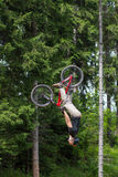 Backflip of biker in the mountains Royalty Free Stock Images