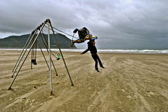 Backflip Out of Swings on Beach in Oregon Stock Images