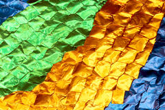 Backg för textur för folie för blad för mång- skinande bladbrons för färg skinande Arkivfoto