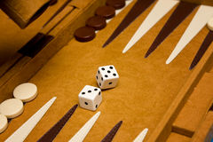 Backgammon. Travel backgammon set with rolling dice royalty free stock image