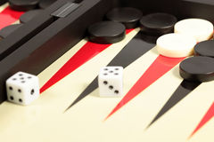 Backgammon. A backgammon board and two dice Stock Image