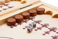 Backgammon. View of dice and game pieces during backgammon game. Double five Stock Photo