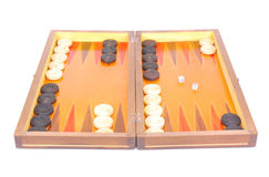 Backgammon. An old used traditional wooden complete Backgammon board with buttons and dices. Image isolated on white studio background Stock Images