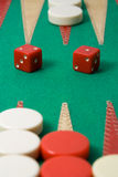 Backgammon. Two red dice and counters on a backgammon board Stock Photo