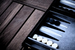 Backgammon. Board on a wooden table.  Brett auf Holztisch Stock Photos