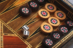Backgammon. The backgammon and dice with six double Stock Photos