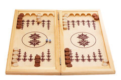 Backgammon board. View of dice and game pieces on a backgammon board at the beginning of a game Stock Photography