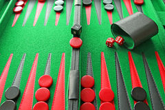 Backgammon board game. Photo of a backgammon board game with red and black counters,dice.doubling cube,shaker.ideal for gaming entertainment etc royalty free stock photography