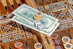 Backgammon Board, two hundred dollar and two dice Stock Photography