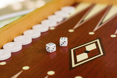 Backgammon bone square white dice for gambling with blurred background Royalty Free Stock Image