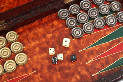 Backgammon. In the carved box inlaid with skin, counters and bones on a white background Stock Photo