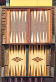 Backgammon. Carved wooden table for backgammon board game Royalty Free Stock Photo