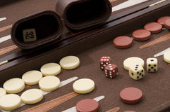 Backgammon Close Up. Backgammon Set with chips,dice,container and board Stock Photography