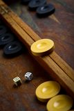 Backgammon. Color detail of a Backgammon game with two dice Royalty Free Stock Photo