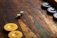 Backgammon. Color detail of a Backgammon game with two dice Stock Photography