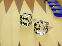 Backgammon Dice. Photo of Dice on Backgammon Board - Part of Series Royalty Free Stock Image