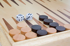 Backgammon and dice. Wooden board for game in a backgammon and dice Stock Photography