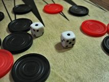 Backgammon dice and chips royalty free stock image