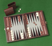 Backgammon game. And dice on a green background stock photography