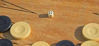 Backgammon game. Dice and pieces of backgammon game royalty free stock images