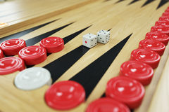 Backgammon game and dices on game board. Closeup Stock Photography