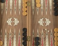Backgammon game with two dice. Detail of a backgammon game with two dice close up royalty free stock photos