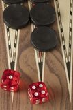 Backgammon game with two dice. Detail of a backgammon game with two dice close up stock photo