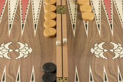 Backgammon game with two dice. Detail of a backgammon game with two dice close up stock photography