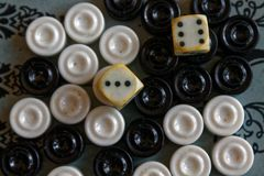 Backgammon opened, mini table game for journey, top view stock photography