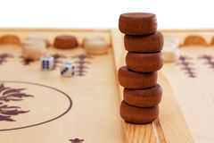 Backgammon pieces. A stack of game pieces at a backgammon board Stock Photography